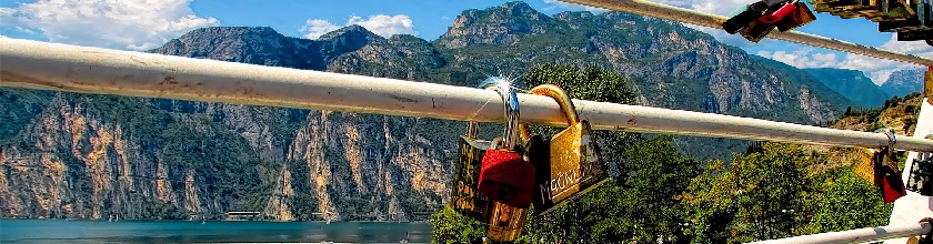 Locks in front of a mountain
